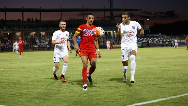 San Antonio FC's Max Gunderson (left) and Taylor Morgan (right) chase try to win possession during a match against Arizona United SC. Photo courtesy of Arizona United SC/USL.