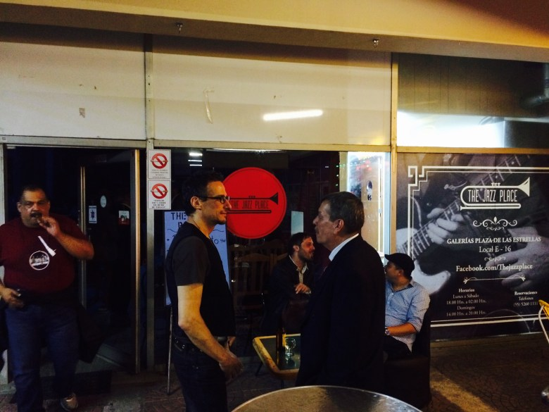 Sax man Diego Maroto (center) and Deputy Secretary of Economic Development Ricardo Chelen chat during a break at The Jazz Place. Photo courtesy of Adam Tutor