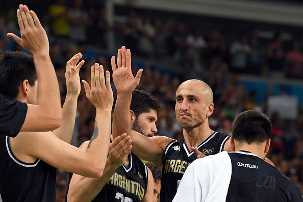 Argentina's shooting guard Manu Ginobili (R) taps hands with his teammates after losing to USA during a Men's quarterfinal basketball match between USA and Argentina at the Carioca Arena 1 in Rio de Janeiro on August 17, 2016 during the Rio 2016 Olympic Games. Photo by Mark Ralston / AFP / Getty Images.