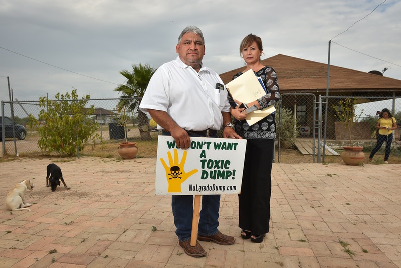 Alejandro Obrégon and his wife, Rocio, stand in front of their home near the site of a landfill proposed by developer C. Y. Benavides, about 20 miles east of Laredo. Their daughter, Abigail, is at right. Photo by Robin Jerstad, courtesy of the Texas Tribune.