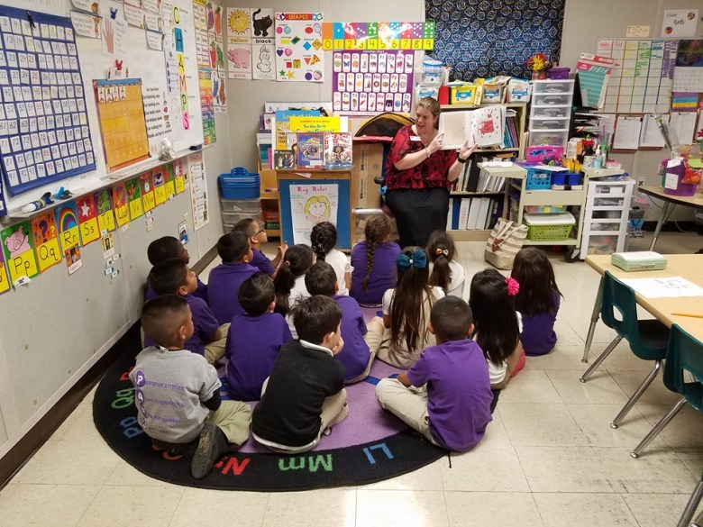 "Nicole France, Coordinator within SAC's Office of Outreach & Recruitment, reads to Will Rogers Elementary students on May 4, 2016 to promote SAC's Wild About Reading Program, a new initiative to promote literacy in SAC' ""backyard."" Photo courtesy of San Antonio College."