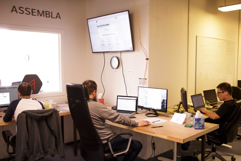 Employees Rae Cabello, Jonathan Stovall, and Marcin Ksiazkiewicz work on Assembla projects in their downtown offices. Photo by Scott Ball.