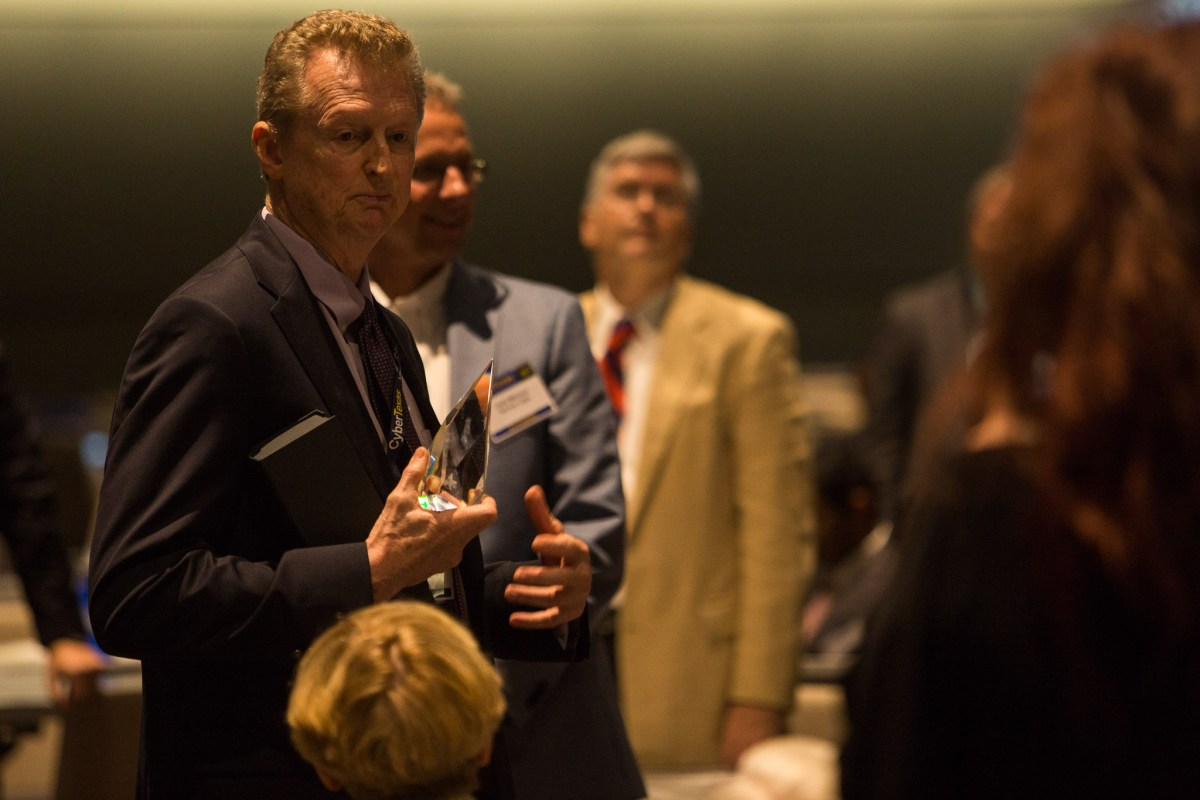 President of SecureLogix Corporation Lee Sutterfield personally thanks his wife after receiving the Hall of Honor award. Photo by Scott Ball.