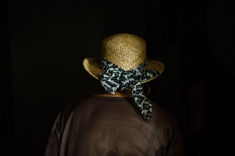 Ethel Jewel Dillard walks down a dark hallway in her former home. Photo by Scott Ball.