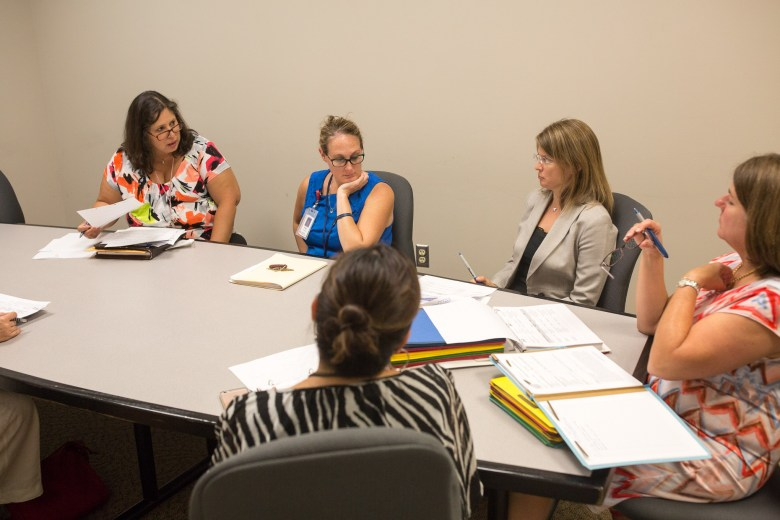 (left to right) Bexar County Juvenile Probation Supervisor Marjorie Altman discusses with UHS-DHCS psychometrist Elisha Best, prosecutor Khristina Fielder, Judge Laura Parker, and Defense Attorney Beatrice Robles during a private meeting before the Crossroads program court session. Photo by Scott Ball.