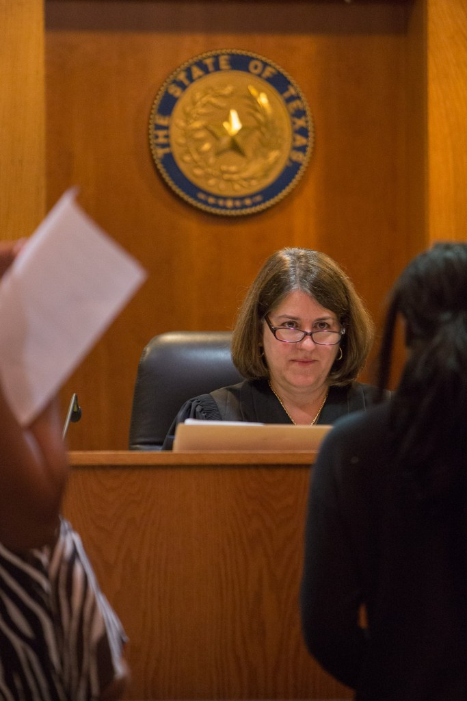 Judge Laura Parker interacts with a Crossroads Program juvenile. Photo by Scott Ball.
