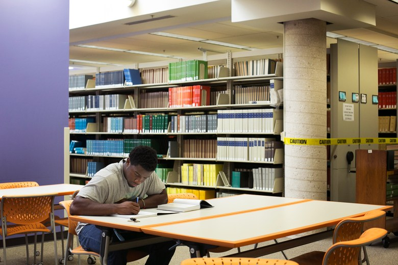 Trinity linebacker Julian Turner, who is also an honors student, takes a study break in the library before practice. Photo by Kathryn Boyd-Batstone.