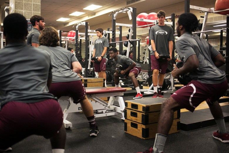 Trinity linebacker Julian Turner (center) and teammates weight weights during practice the day before their opening game. Photo by Kathryn Boyd-Batstone.