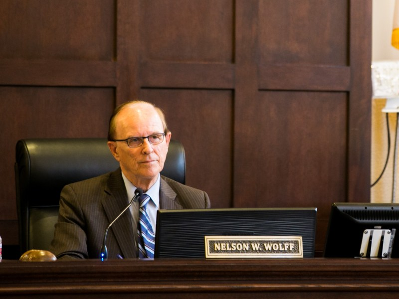 Bexar County Judge Nelson Wolff listens during the public hearing portion of Commissioner's Court. Photo by Kathryn Boyd-Batstone.