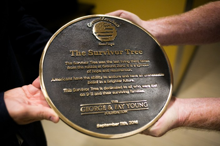 Th plaque that will be placed with the Survivor Tree. Photo by Kathryn Boyd-Batstone.