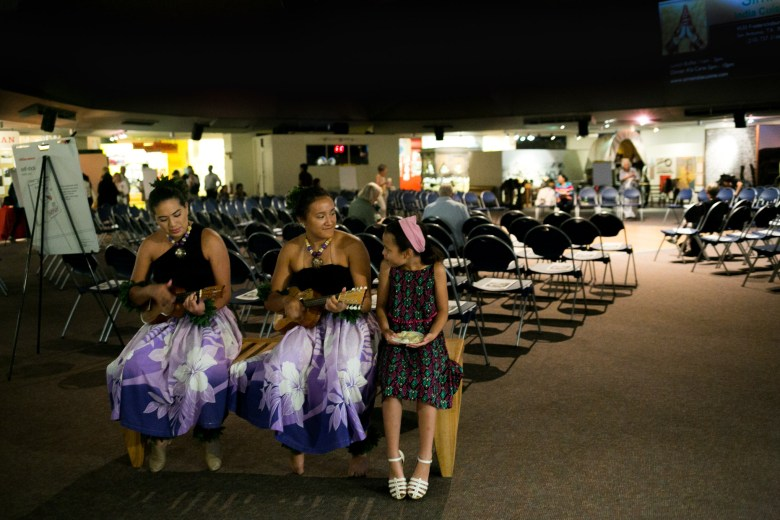 From left: Cheyenne Monroe, Bella Monroe, and Shirrise Hernandez of Hula Halau Ohana Elikapeka sing before their performance. Photo by Kathryn Boyd-Batstone.