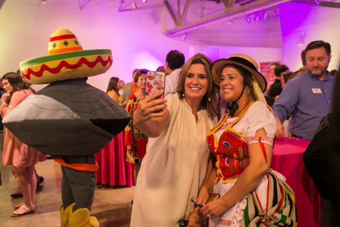 From left: Deaundra Waddell and Mari Tamez, a Canary Island Descendent, take a selfie together during the San Antonio Tricentennial 2018 partners announcement. Photo by Kathryn Boyd-Batstone.