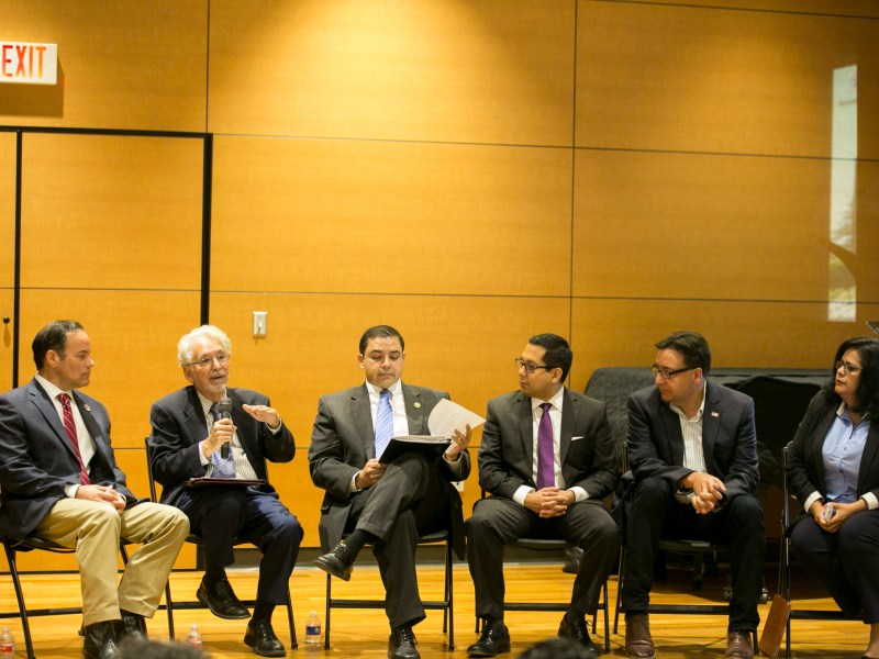 Elected officials and community leaders gather to discuss Latino voter turnout. Photo by Kathryn Boyd-Batstone.