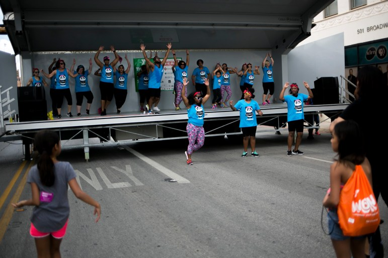 Zumba dancers from YMCA workout on a stage at the end of Síclovía. Photo by Kathryn Boyd-Batstone.