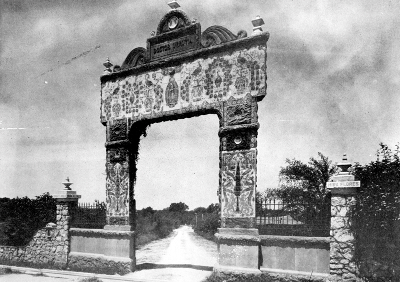 The Urrutia arch was the original entryway into Miraflores from Broadway. Miraflores was originally a 15 acre property forming a rectangle extending east to west from Broadway to the San Antonio River; and north to south from Hildebrand, 2 blocks south to Allensworth. The property was cut in half with the building of the USAA building around 1960, and then later further reduced to its current size of 4.5 acres when it was cleared for parking lots. Photo courtesy of Urrutia Photo Collection.