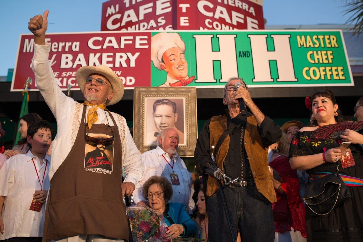 Local artist Jesse Trevino briefly speaks as Jorge Cortez gestures to the audience. Photo by Anthony Francis.