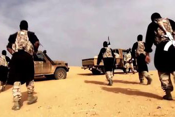 AQIM fighters in a propaganda video, filmed in the Sahara desert by Al-Andalus Media Productions, the media branch of al-Qaeda in the Islamic Maghreb. Photo courtesy of Creative Commons.