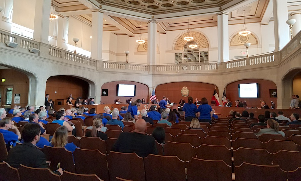 """More than 60 people wore blue """"No Annexation"""" T-shirts to the meeting on Thursday. Photo by Iris Dimmick."""