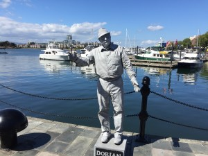 A mime, working the waterfront in Victoria, the capitol of British Columbia, thanks a visitor for a looney, the Canadian dollar. Photo by Robert Rivard.