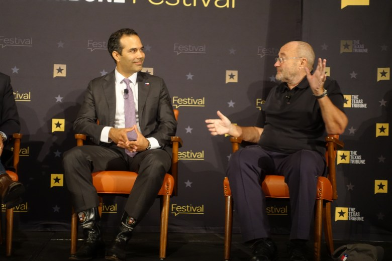 Texas General Land Office Commissioner George P. Bush (left) listens to Phil Collins describe his childhood connection to the Battle of the Alamo. Photo by Robert Rivard.