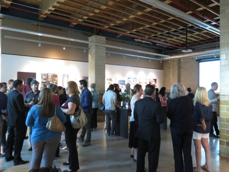 Attendees enjoyed beverages and hors d'oeuvres as they walked around the LIA's Nexo exhibit. Photo by Rocío Guenther.