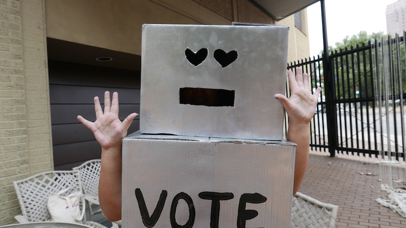 "Noemi ""Liz"" Silva tries on Vote-Bot. Photo by Hannah Lynn."