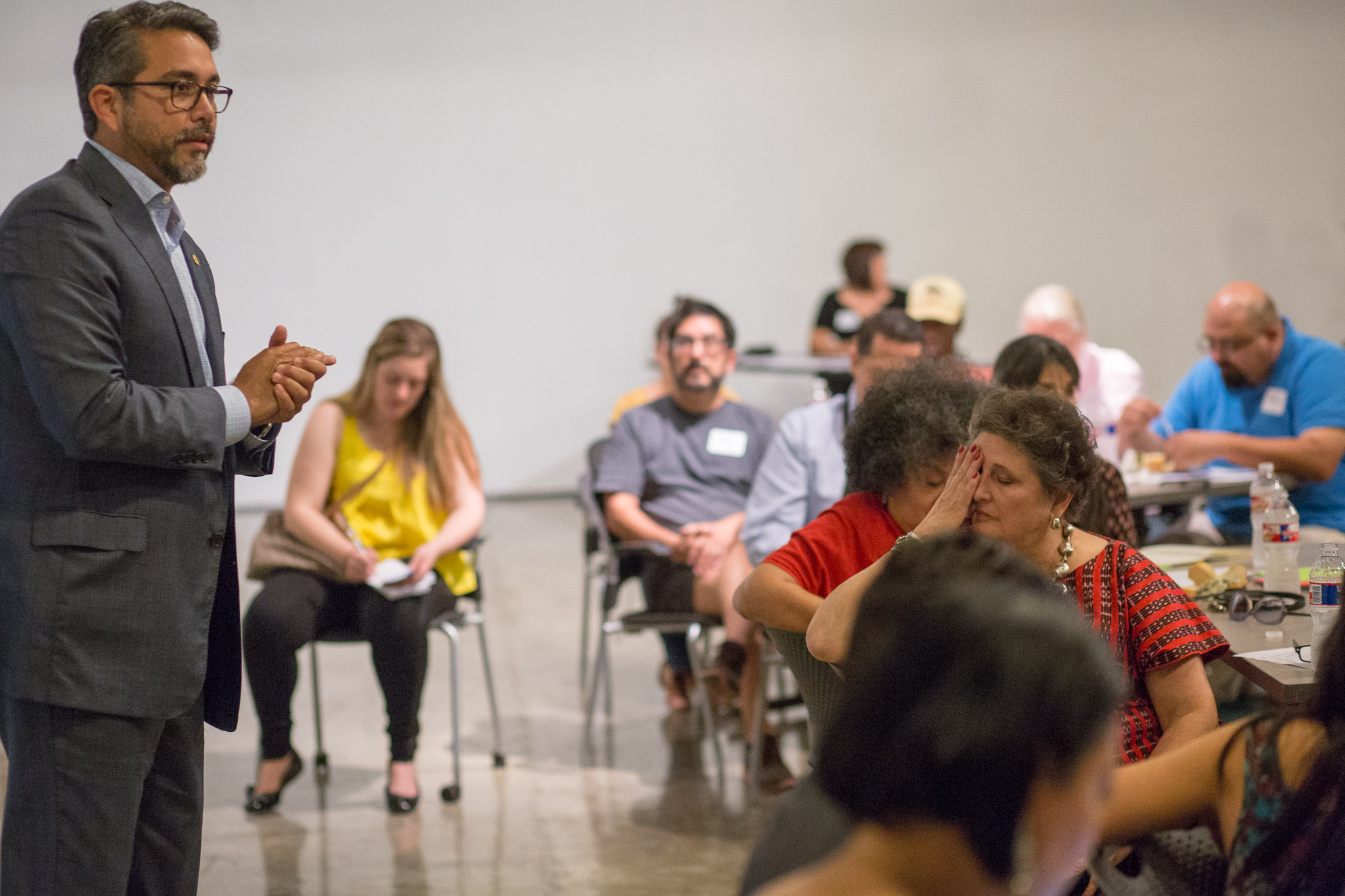 Councilman Roberto Treviño (D1) addresses audience members and discusses the importance of Centro De Artes. Photo by Scott Ball.