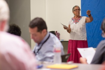 Facilitator Linda Ximenes asks the audience on what they would like to walk away with following the meeting. Photo by Scott Ball.