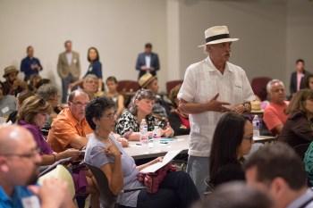 Local artist Armando Sanchez asks a question about the future of Centro de Artes. Photo by Scott Ball.