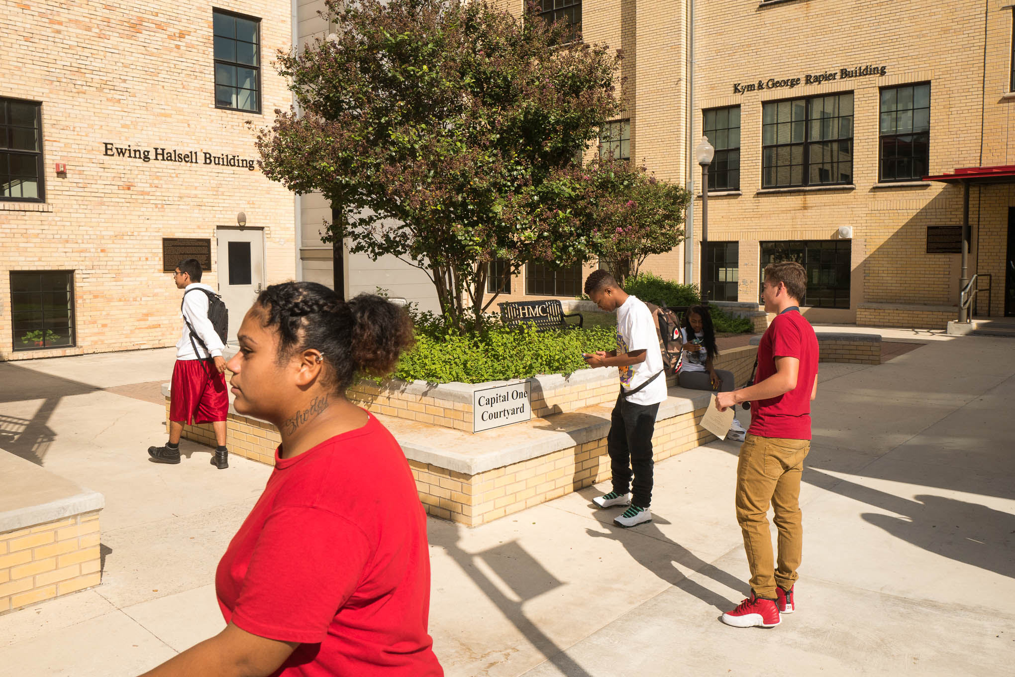 Students at Healy-Murphy walk through the courtyard in-between class. Photo by Scott Ball.