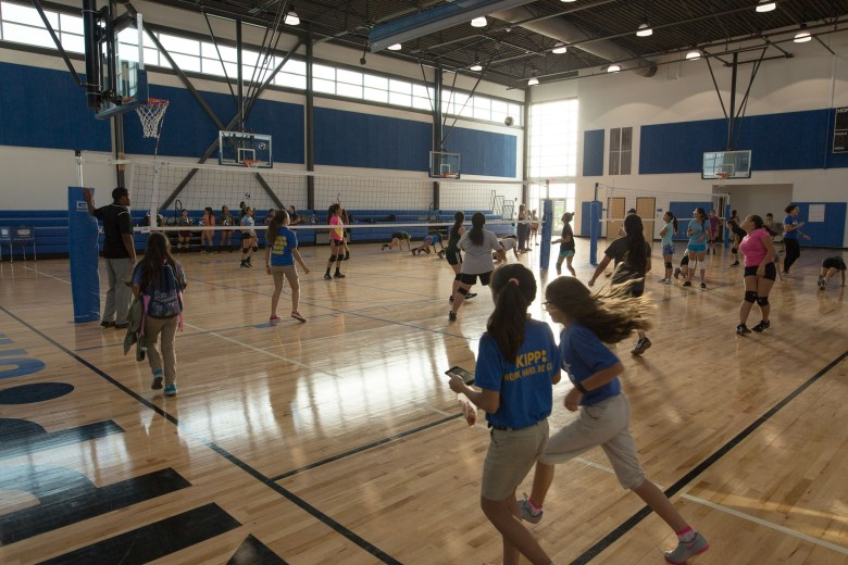 A multi-use gymnasium is used for volleyball practice. Photo by Scott Ball.