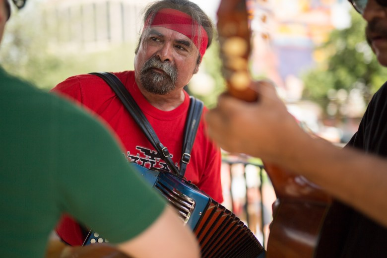 Juan Tejeda practices accordion before performing at Milam Park. Photo by Scott ball.