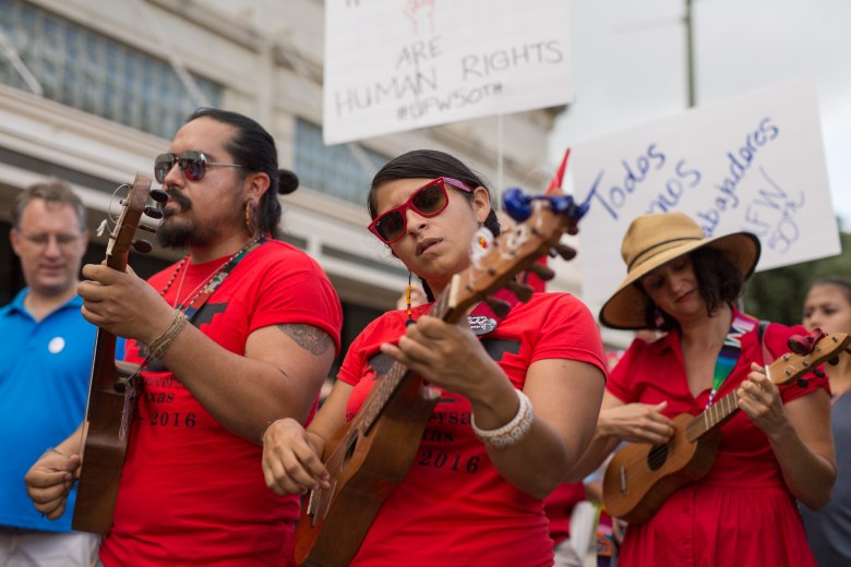 El Tallercito de Son performs while marching south on Flores Street. Photo by Scott Ball.