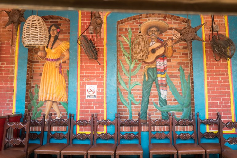 Decorative paintings line the outside waiting area of Mi Tierra. Photo by Scott Ball.