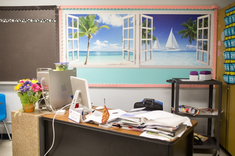 A classroom displays illustrations of windows in hopes of receiving the same effect. Photo by Scott Ball.