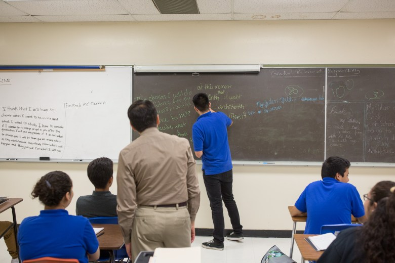 Old chalkboards and stained ceiling panels are common at Lanier High School. Photo by Scott Ball.