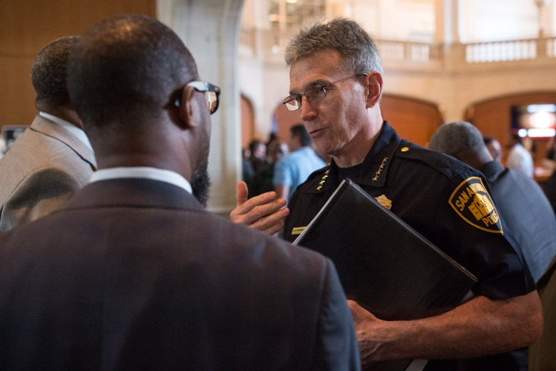 San Antonio Police Chief William McManus discusses with community members following the passed contract. Photo by Scott Ball.