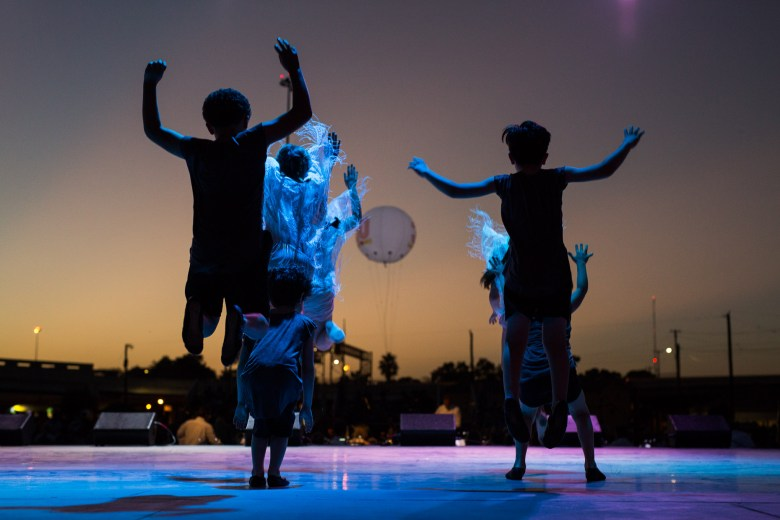 Children performers jump up and down during the performance of Las Fundaciones de Béjar. Photo by Scott Ball.