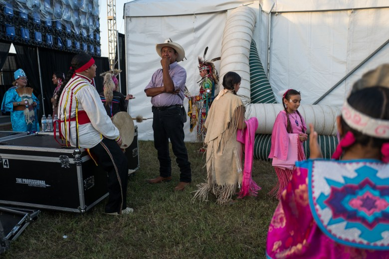 American Indians in Texas Dance Theater practice backstage before a performance. Photo by Scott Ball.