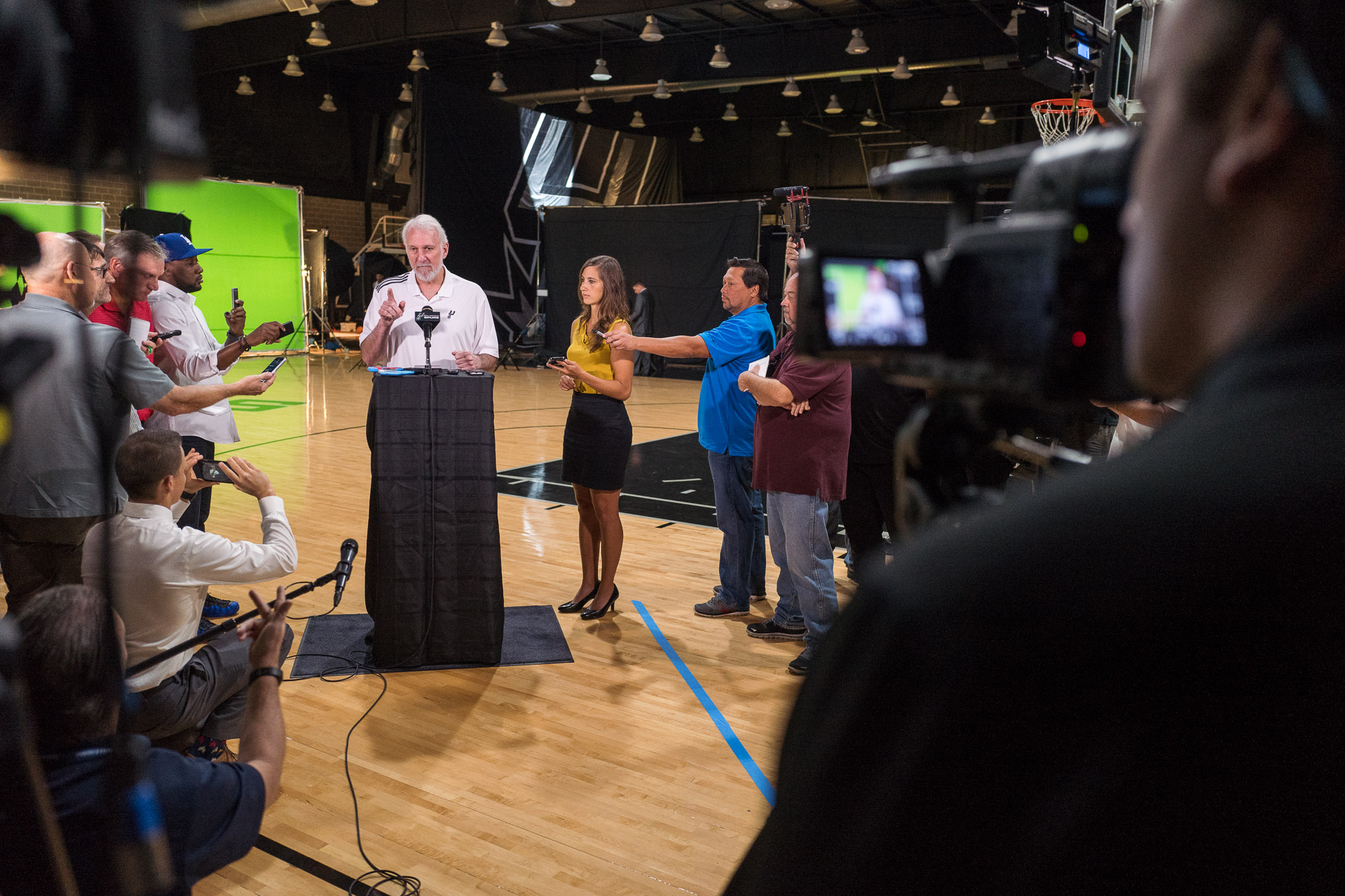 San Antonio Spurs Head Coach Gregg Popovich responds to a reporter during a press conference. Photo by Scott Ball.