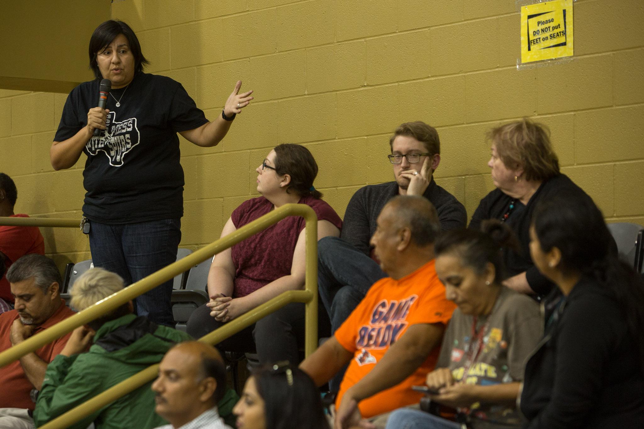 (top left) Eastside resident Michelle Griego responds to resident Romualdo Orta. Photo by Scott Ball.