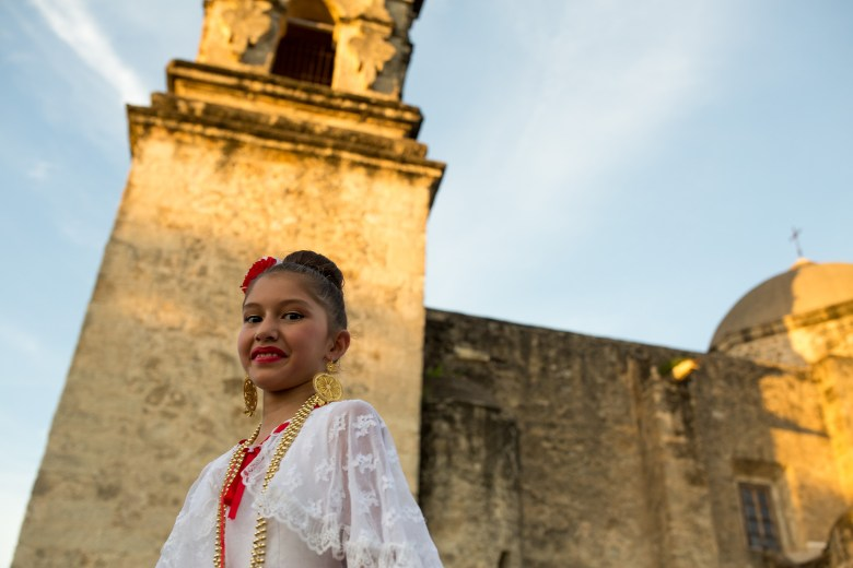 Samantha, 9, dances during a performance in front of Mission San José. Photo by Scott Ball.