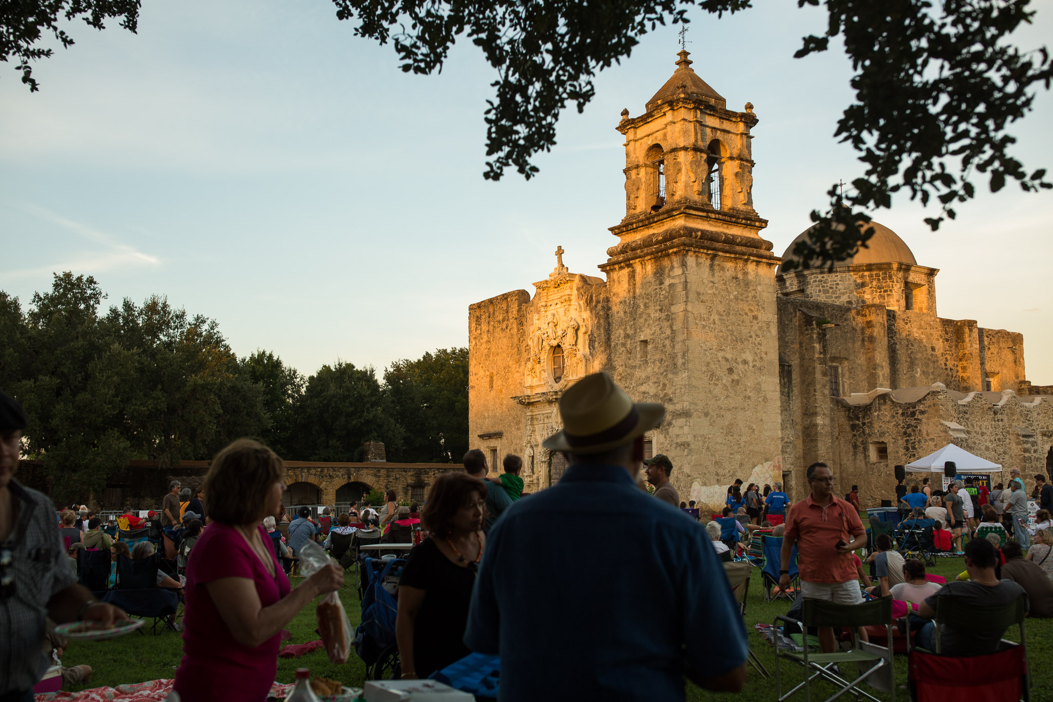 Hundreds gathered in front of Mission San José during the Restored by Light event. Photo by Scott Ball.