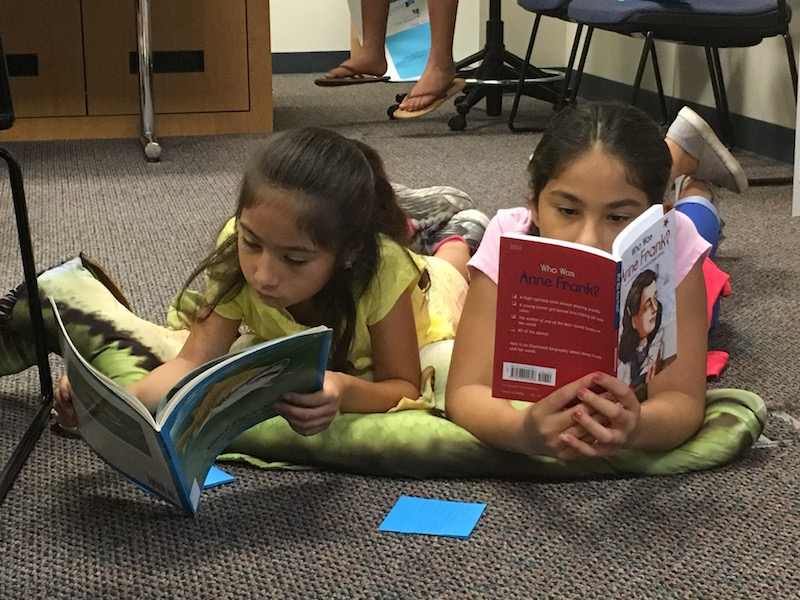 Students reading at UTSA's La Plaza de Lectura, now the Center for Inquiry of Transformative Literacies. Courtesy photo.
