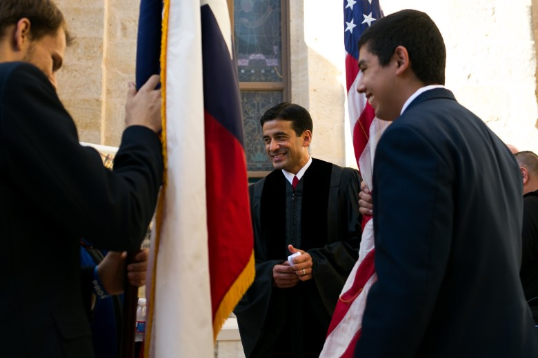 Criminal District Attorney of Bexar County Nico LaHood awaits the Red Mass procession. Photo by Kathryn Boyd-Batstone.