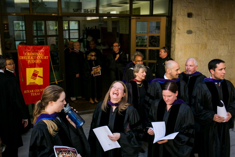 St. Mary's University lawyers share a laugh before the Red Mass procession. Photo by Kathryn Boyd-Batstone.