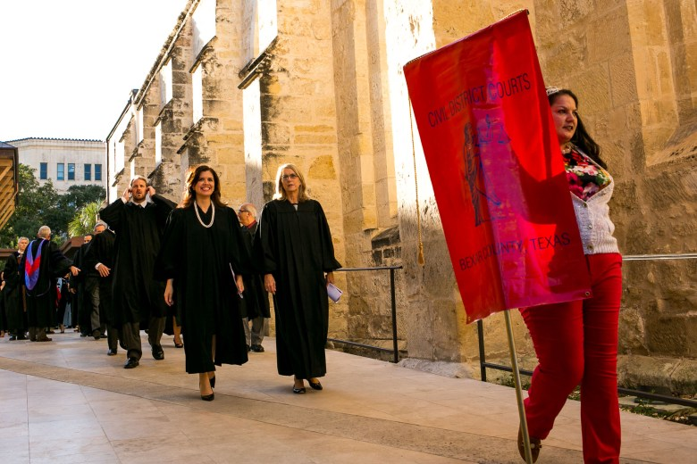 St. Mary's University faculty and Civil District Courts representatives proceed along San Fernando Cathedral. Photo by Kathryn Boyd-Batstone.