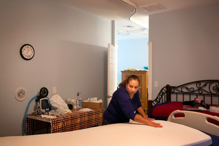 Sonia Alvarado changes her son's bed everyday and sprays it with Lysol to make sure everything is sterile and void of germs. Photo by Kathryn Boyd-Batstone.