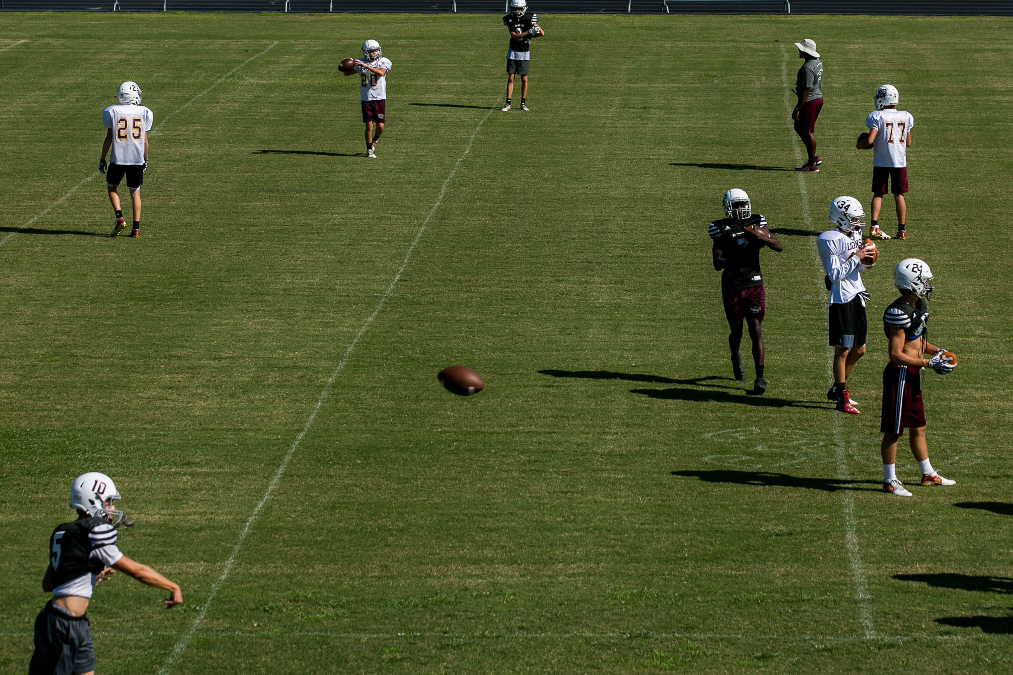 San Antonio Christian football team warms up for practice.