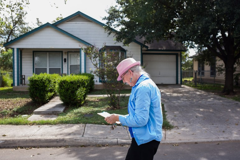 SAISD Board President Patti Radle block walks along Angela Street on the Westside to inform voters about the Tax Ratification Election and bond money.